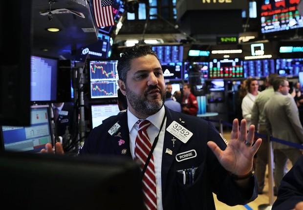 Fundos americanos que operam em Wall Street concentram boa parte dos títulos da dívida da Venezuela (Foto: Getty Images via BBC)