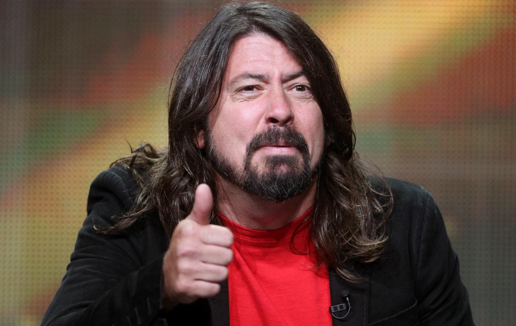 """Dave Grohl disse que gravar álbum e reality ao mesmo tempo foi """"um p*** pé no saco"""". (Foto: Getty Images)"""