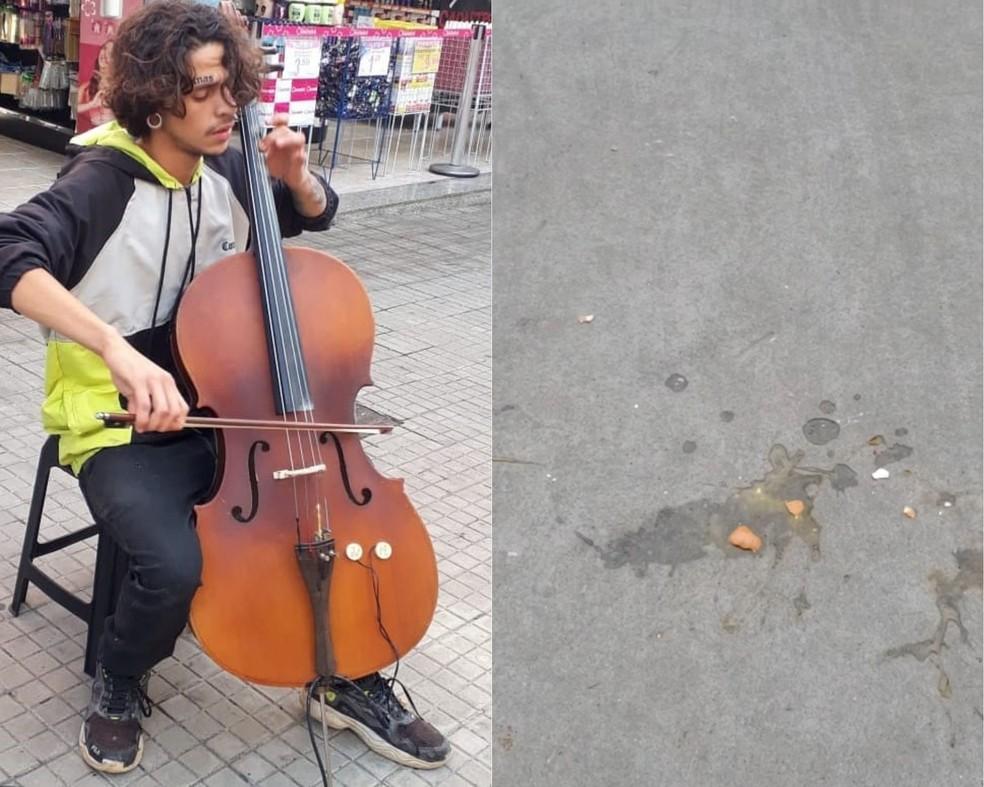 Músico levou ovada enquanto se apresentava em rua movimentada em Santos, SP — Foto: Reprodução/Redes sociais