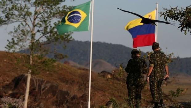 Enquanto EUA insistem em dizer que uma ação militar na Venezuela não está descartada, o governo brasileiro repete que não cogita usar a força contra o governo de Nicolás Maduro. O que explica posição de cautela do Brasil? (Foto: BRUNO KELLY/REUTERS via BBC)