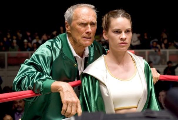 Com Hillary Swank no filme 'Meniina de Ouro', de 2004