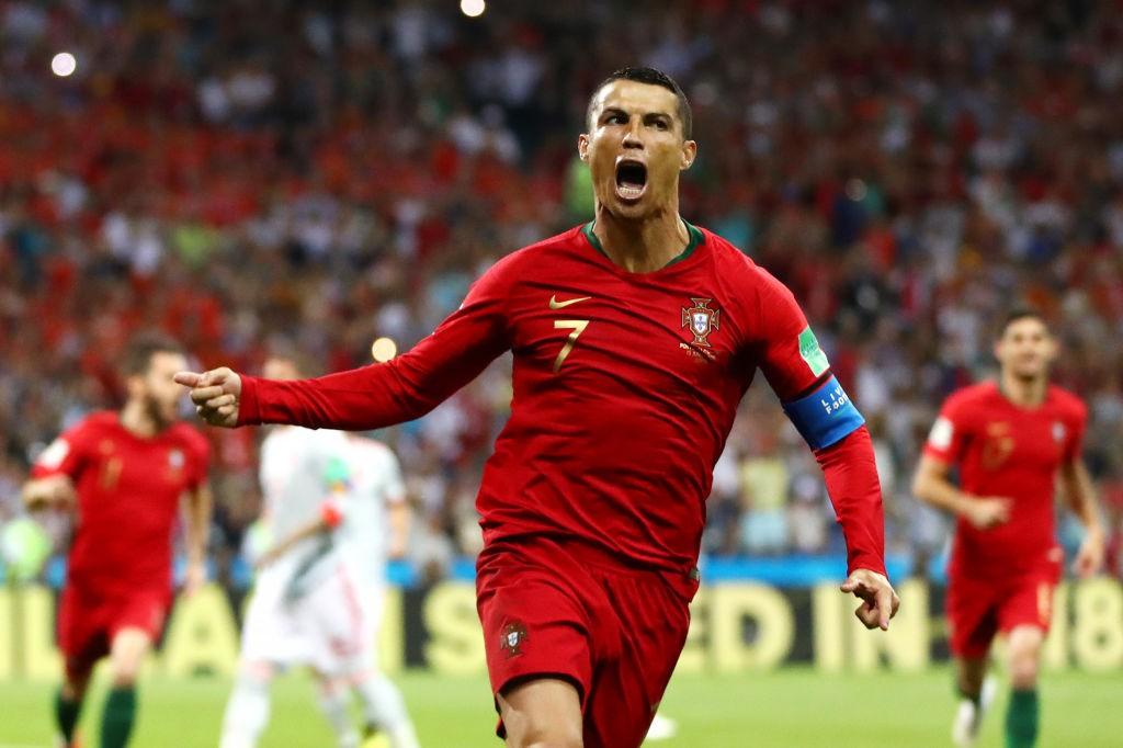 Cristiano Ronaldo comemora um de seus gols contra a Espanha na Copa da Rússia (Foto: Getty)