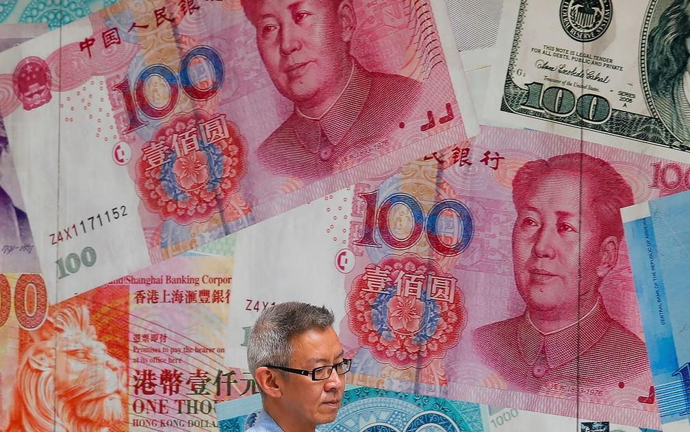 Repressão contra manifestantes poderia comprometer a capacidade da China de comercializar internacionalmente — Foto: AP Photo/Kin Cheung