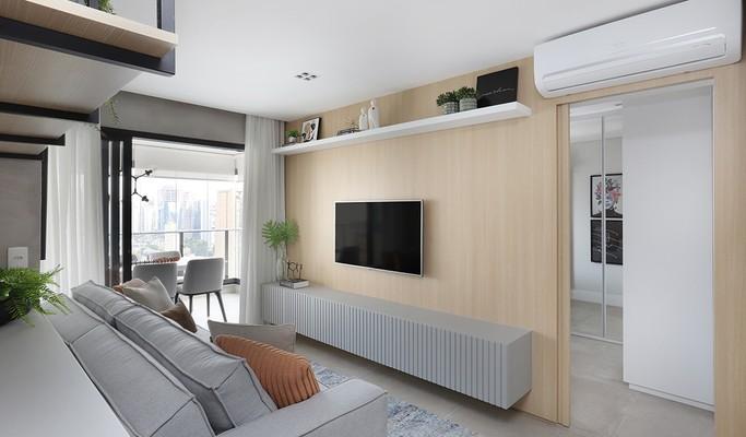 Projeto integra ambientes e amplia área social de apê de 52 m²