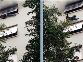 Homem pula da janela de apartamento para fugir de incêndio (TV Globo/Reprodução)