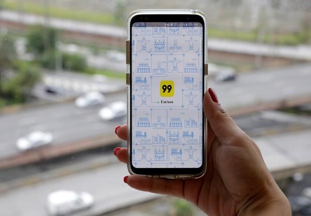 Aplicativo 99 - táxi - corrida - sharing - unicórnio (Foto: Paulo Whitaker/Reuters)