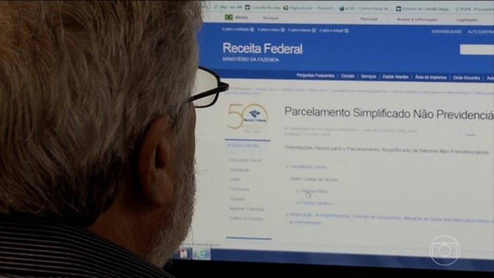 Para saber se teve a declaração liberada, o contribuinte deverá acessar o site da Receita ou ligar para o Receitafone 146.  (Foto: Reprodução/TV Globo)