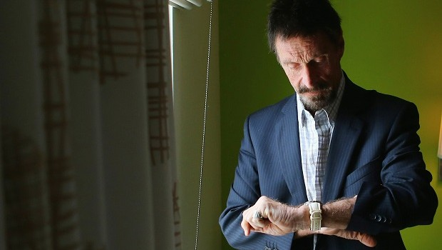Tycoon John McAfee in a hotel room at 2012 (Photo: Joe Reidle / Getty Images)